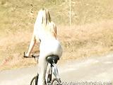 Katherina topless on bike