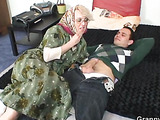 Young man takes blonde granny