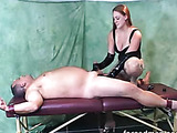 Bitch in latex gloves beating cock