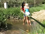 Blonde and brunette lesbians fuck outdoors