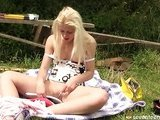 Blonde oiling her clit with a lip gloss