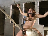 Alluring brunette gets masochistic pleasure from a pretty blonde as she is bound while being ass and pussy fucked by different dildos
