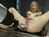 Blonde bitch with shaggy twat and clamps on her nipples gets her pooper tortured with four sybian dildos at a time