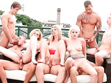 Busty chicks fucking with a group of horny bisexuals on the roof