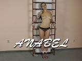 Sexy and slim blonde beauty is tied nice and tight to a shell board with a lovely crotch rope over her sweet pussy