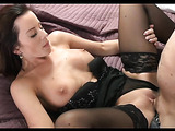 Black haired milf enjoying the orgasm that she gets from riding his big cock.