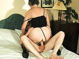 Slutty grey granny in stockings and corset riding a dick passionately