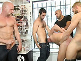 A group of gays abusing and fucking hard a guy in the shop