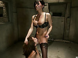 Busty ponytailed maitress in nylons fucking her slave girl with strap-ons while stimulating her with wire applicators