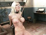 Big-titted blondie in red haigh heels getting flogged while being squeezed out in bdsm training center