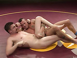 Two furious gays pounding a guy from both ends after a wrestling match in the locker room