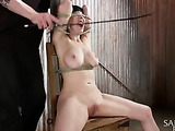 Busty brunette chick gets jeered cruelly when bound and suspended by kinky master