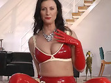 Gorgeous brunette MILF all in latex suit rubbing her slit on camera