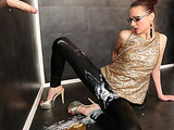 Red babe in glasses takes off her pants to stuff a gloryhole cock into her itchy pussy
