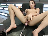 Hot looking girl gets pounded hard and fast by automated cock machines