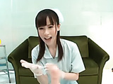 Nice Japanese nurse practicing a handjob with a dildo