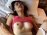 Sexy Japanese chick in a pink vest gets banged from behind