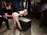 Blonde sweetie with a shaved muff gets it stimulated with a vibro and drilled by kinky master while being roped