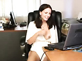 Busty brunette MILF in a white dress takes facial after a cool titjob