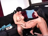 Naked chick with big hot boobs lays down and spreads wide on a dark blue couch while letting her girlfriend lick her pussy before she grabs her long hard pink dildo and screws it in her girl's crack.