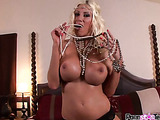 Boobilicious blondie in high heels and beads stuffing her necklace into her snatch