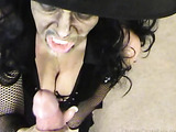 Busty bitch in a Halloween witch make-up and costume looking really horrible while blowing a dick