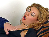 Delectable fox in a tight shirt gets fingered on a tiger pattern daybed.