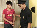 Police officer in aviator sunglasses questions spritely but timid teen in a burgundy shirt.