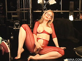 Sexy busty inviting milf in red mesh outfit gets naughty and plays with pussy