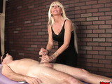 Delicious blonde whore in a black top and pants pulls on the prick of a blindfolded perv.