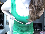 Lusty chick juggles her large tits wearing her sexy green shirt then strips down her green panty and displays her juicy butt before she gets naked and stabs her crack with a violet vibrator as she sits on a white chair and speads her legs.