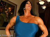 Raven-haired beefcake shows off her muscles and thick veins running through them