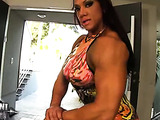 Buff hottie likes showing off her big tits, muscles, and pierced pussy